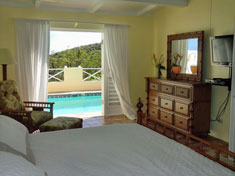 Bedroom suites open to thee pool and views